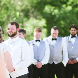 groom at outdoor wedding